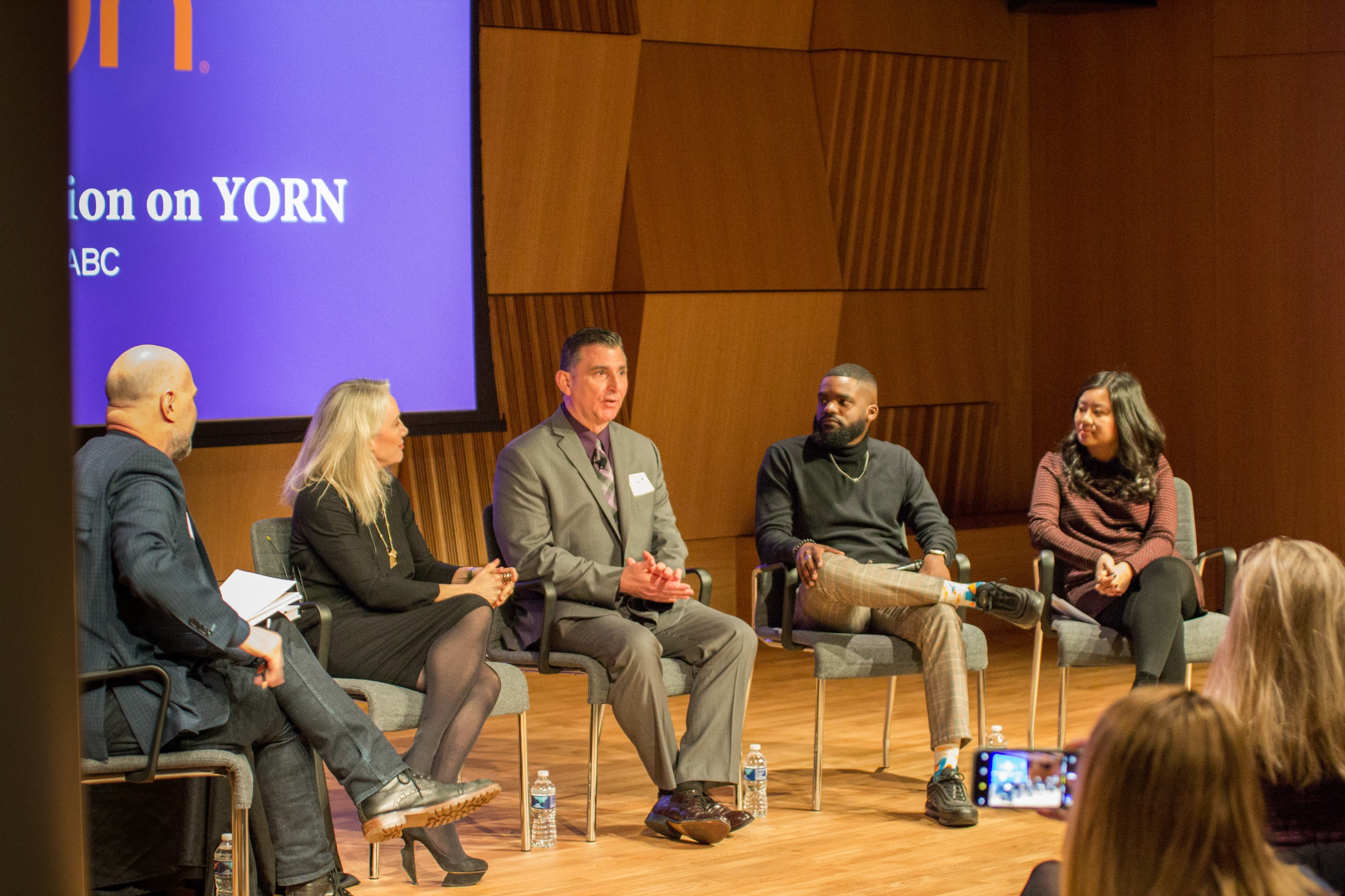 Photo of Defining Innovation speakers sitting on stage talking