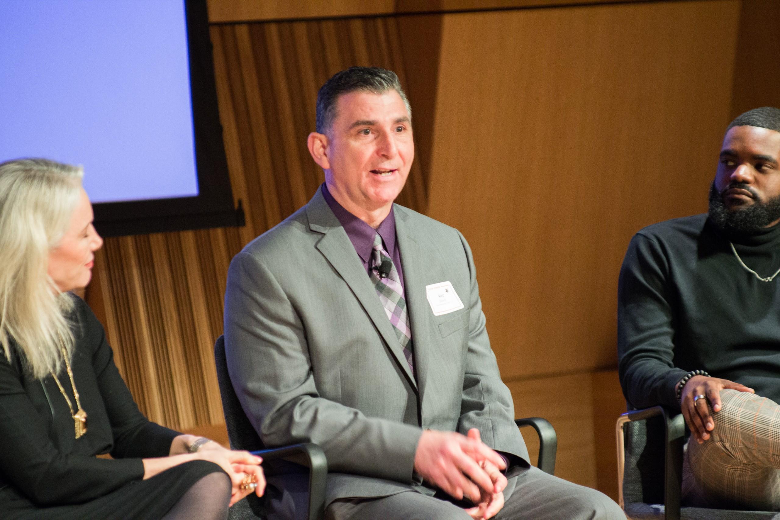 Photo of Defining Innovation speakers sitting on stage speaking