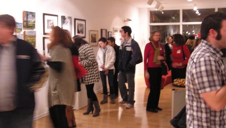 Patrons viewing art at The Art Trust at Meridian Bank